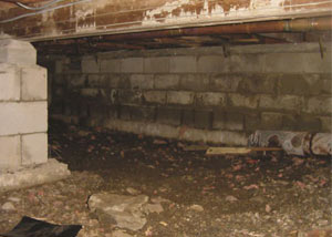 Rotting, decaying crawl space wood damaged over time in Greene
