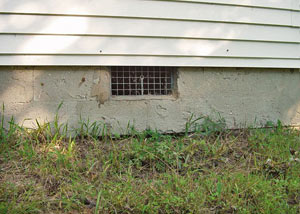 Open crawl space vents that let rodents, termites, and other pests in a home in Walton