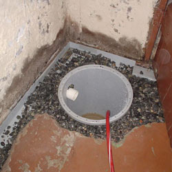 Installing a sump in a sump pump liner in a Elmira home