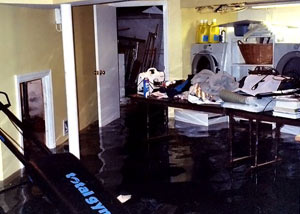 A laundry room flood in Pine City, with several feet of water flooded in.