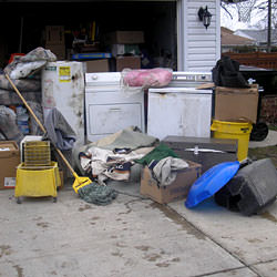 Soaked, wet personal items sitting in a driveway, including a washer and dryer in Horseheads.