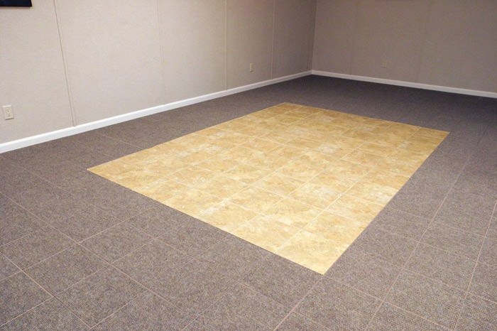 tiled and carpeted basement flooring installed in a Vestal home