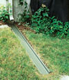 A recessed gutter drain extension installed in Unadilla, New York