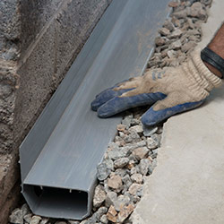 installing a drain tile system in a Delhi home